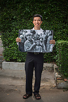 Tran Van Giap in Ho Chi Minh city 2014 holds the photograph of him being examined by Fred Hollows in 1992.