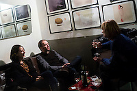 ROME, ITALY - 6 January 2014: Customers have drinks at Cargo, which calls itself a wine bar and art gallery, in the Pigneto neighborhood of Rome, Italy, on February 6th 2014.