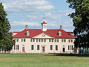 Mount Vernon, Virginia, was the plantation home of George Washington, the first President of the United States (1789-1797). The mansion is built of wood in neoclassical Georgian architectural style on the banks of the Potomac River. Mount Vernon estate was designated a National Historic Landmark in 1960 and is owned and maintained in trust by The Mount Vernon Ladies' Association. The estate served as neutral ground for both sides during the American Civil War, although fighting raged across the nearby countryside. George Washington (born 1732, died 1799) was one of the Founding Fathers of the United States of America (USA), serving as the commander-in-chief of the Continental Army during the American Revolutionary War, and presiding over the convention that drafted the Constitution in 1787. Washington, D.C. (the District of Columbia, capital of the United States) is named for him, as is the State of Washington on the Pacific Coast.
