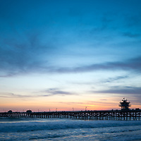 Orange County pier San Clemente California sunset photo. San Clemente is a beach city along the Pacific Ocean in the Western United States of America. Photo is high resolution. Copyright ⓒ 2017 Paul Velgos with All Rights Reserved.