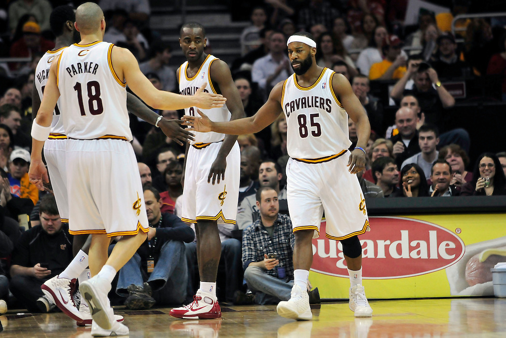 March 6, 2011; Cleveland, OH, USA; Cleveland Cavaliers point guard Baron Davis (85) celebrates with teammates power forward J.J. Hickson (21) and shooting guard Anthony Parker (18) after hitting a jump shot against the New Orleans Hornets during the second quarter at Quicken Loans Arena. Mandatory Credit: Jason Miller-US PRESSWIRE