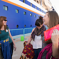 Robyn Schmitz from Ithaca College (left) and Annie Roche from Stetson University (right) share a laugh while waiting to board the MV Explorer on Embarkation day for the Semester at Sea Spring 2014 Voyage, January 10th 2014, in Ensenada, Mexico.