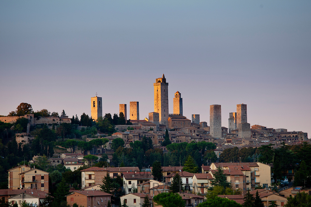 Contrast of contemporary and quaint medieval architecture of San Gimignano and its famous towers in Tuscany, Italy RESERVED USE - NOT FOR DOWNLOAD - FOR USE CONTACT TIM GRAHAM