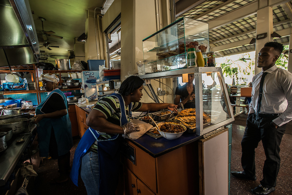 PORT OF SPAIN, TRINIDAD - FEBRUARY 15, 2017: In the shadow of the Hyatt Hotel, just off traffic-packed Wrightson Road, the much-beloved Breakfast Shed serves up an array of local food from a collection of small food stalls with names like Bern's Tasty Pot and Dollo's Delights. The Shed opens early in the morning, from 6, and is the place to come for pillowy fried bread, stewed okra and eggplant, and salted and fried fish (around 35TT). Wash your breakfast down with a fresh juice in flavors like tamarind and sorrel (hibiscus). The no frills picnic tables look right out onto the water and the place has a calm atmosphere that's a refreshing change from the busy street behind it.  PHOTO: Meridith Kohut for The New York Times