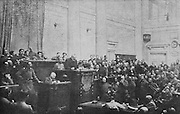 Congress of delegates of Front Line Troops, with Alexander Guchkov, minister of war for the Provisional Government (before Kerensky), explaining the reasons behind his resignation, during the Russian Revolution, in the Duma chamber - the bronze imperial coat of arms has been taken from the rostrum and soldiers and officers take the place of politicians, photograph published in L'Illustration no.3876, 16th June 1917. Picture by Manuel Cohen