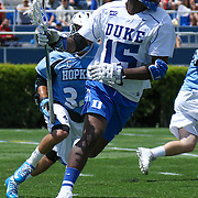 Duke Midfielder Myles Jones (15) attempts to pass the  during the second half of The NCAA Division I Men's Lacrosse Tournament game between the Defending national champion Duke and No. 8 ranked Johns Hopkins Sunday, May. 18, 2014 at Delaware Stadium in Newark, DEL