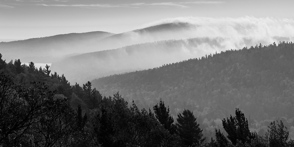 Morning fog rolls over the hills near Copper Harbor<br />