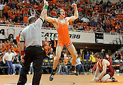 Oklahoma State's Brandon Mason celebrates after winning in the final seconds against Oklahoma's Ryan Smith during the Bedlam Series wrestling match in Stillwater, OK.