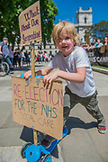 Teo Lewis Whitehead, aged 4, joins his mum to ask whats in it for his generation and to ride his scooter - A day after the election result protestors gather to ask for Theresa May to quit and not do a deal with the DUP. Who people fear because of their views on abrtion, gay marriage etc. Westminster, London, 10 Jun 2017