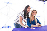 HOUSTON, TX - OCTOBER 3:  Paige VanZant poses for a photo with a fan during the UFC 192 fan village at the Toyota Center on October 3, 2015 in Houston, Texas. (Photo by Cooper Neill/Zuffa LLC/Zuffa LLC via Getty Images) *** Local Caption *** Paige VanZant