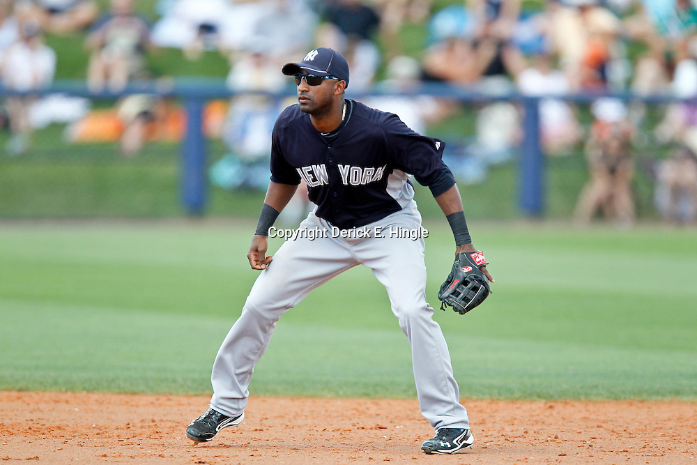 March 21, 2012; Port Charlotte, FL, USA; New York Yankees shortstop Eduardo Nunez (26) against the Tampa Bay Rays during a spring training game at Charlotte Sports Park.  Mandatory Credit: Derick E. Hingle-US PRESSWIRE