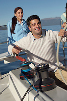 Man Turning Winch on Sailboat