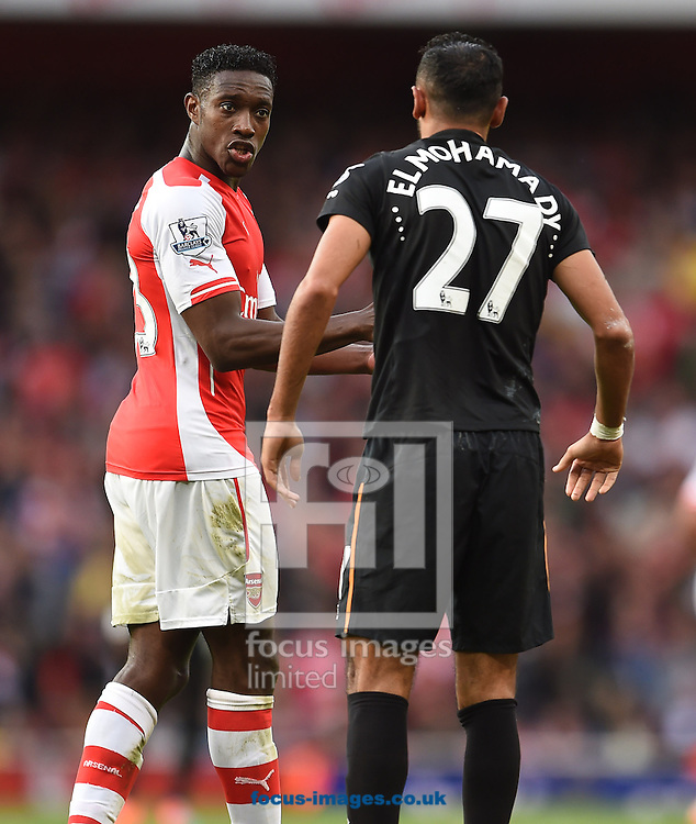Danny Welbeck of Arsenal and Ahmed Elmohamady of Hull City during the Barclays Premier League match at the Emirates Stadium, London<br /> Picture by Andrew Timms/Focus Images Ltd +44 7917 236526<br /> 18/10/2014