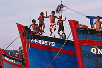 Boys playing in the harbor, Nha Trang, Vietnam