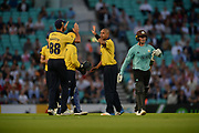 Grant Elliott and Jeetan Patel of Birmingham Bears celebrate the wicket of Jason Roy of Surrey during the NatWest T20 Blast South Group match between Surrey County Cricket Club and Warwickshire County Cricket Club at the Kia Oval, Kennington, United Kingdom on 25 August 2017. Photo by Dave Vokes.
