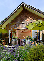 The Tasting Room at Symphony Vineyard near Victoria, BC overlooks the family-owned vineyard below.