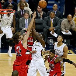 Dec 30, 2013; New Orleans, LA, USA; New Orleans Pelicans point guard Jrue Holiday (11) shoots over Portland Trail Blazers center Robin Lopez (42) during the first half of a game at the New Orleans Arena. Mandatory Credit: Derick E. Hingle-USA TODAY Sports