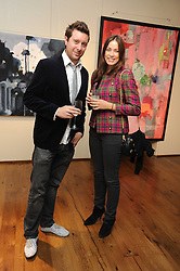 CRESSIDA WILSON and LUKE COLSON at an exhibition of Tahnee Lonsdale's paintings held at The Commander, 47 Hereford Road, London on 8th October 2008.