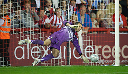 BRENTFORD, ENGLAND - Tuesday, September 21, 2010: Brentford's goalkeeper Richard Lee saves a penalty from Jermaine Beckford during the penalty shoot-out during the Football League Cup 3rd Round match at Griffin Park. (Photo by David Rawcliffe/Propaganda)