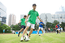 GUANGZHOU, CHINA - Wednesday, July 13, 2011: Local youngsters during a Liverpool FC coaching clinic at the Guangzhou Sports University during day three of the club's Asia Tour. (Photo by David Rawcliffe/Propaganda)
