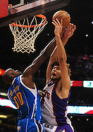 Mar. 14 2010; Phoenix, AZ, USA; Phoenix Suns center Robin Lopez (15) puts up a shot against New Orleans Hornets center Emeka Okafor (50) in the second half at the US Airways Center. The Suns defeat the Hornets 120 to 106. Mandatory Credit: Jennifer Stewart-US PRESSWIRE.