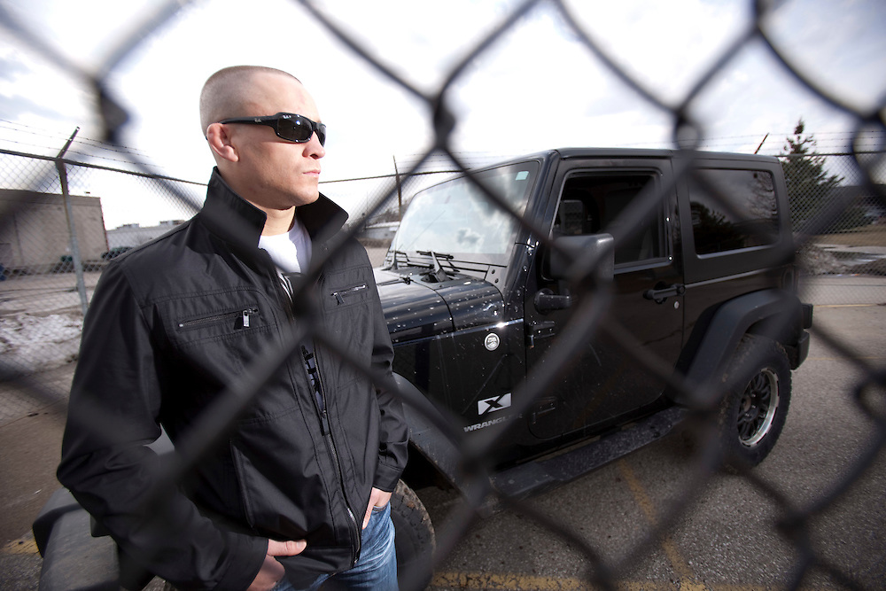 London, Ontario ---11-03-18--- UFC fighter Mark Hominick stands with his his Jeep Wrangler outside of his training gym, Adrenaline Training Center, in London, Ontario, March 18, 2011.<br /> GEOFF ROBINS The Globe and Mail
