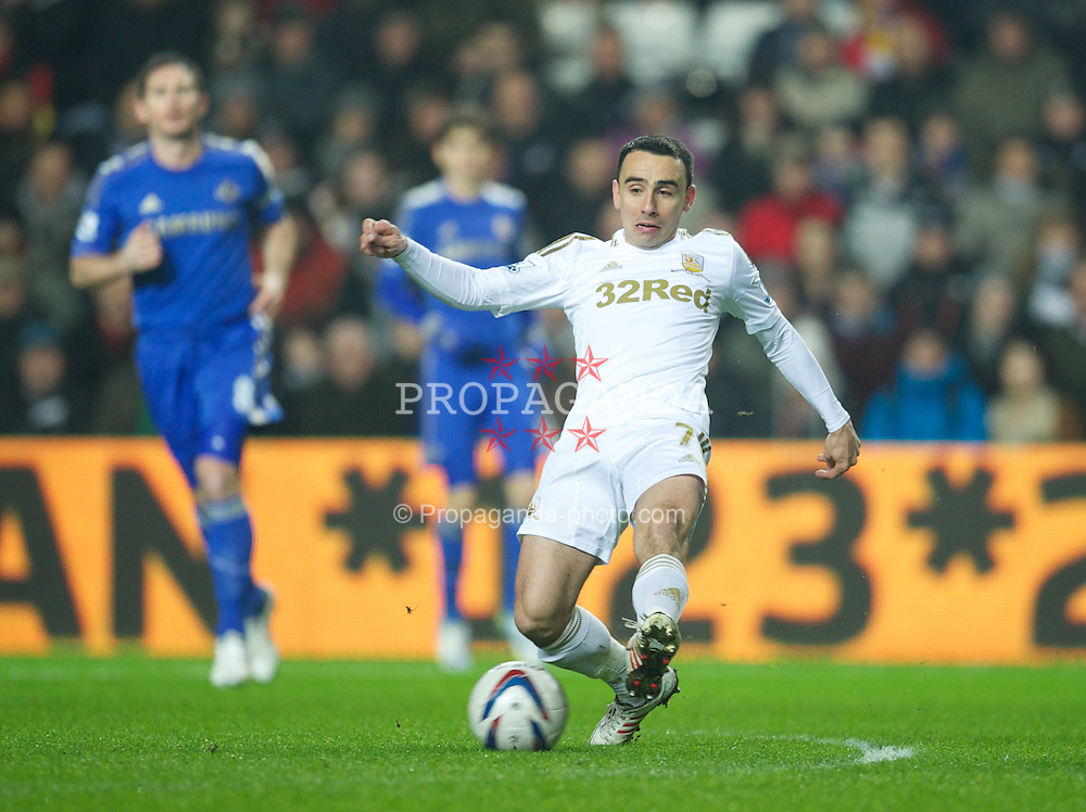 SWANSEA, WALES - Wednesday, January 23, 2013: Swansea City's Leon Britton in action against Chelsea during the Football League Cup Semi-Final 2nd Leg match at the Liberty Stadium. (Pic by David Rawcliffe/Propaganda)