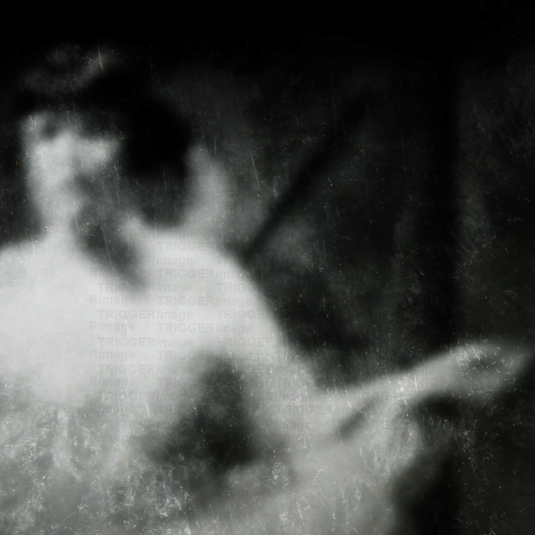 blurred and scratched image of a dancer with arm outstretched