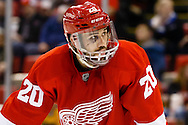 Apr 2, 2015; Detroit, MI, USA; Detroit Red Wings left wing Drew Miller (20) is seen with sixy stitches in his face as he waits for the face off during the third period against the Boston Bruins at Joe Louis Arena. Boston won 3-2. Mandatory Credit: Rick Osentoski-USA TODAY Sports