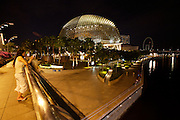"""Esplanade Theatres On The bay (Cultural Centre, dubbed """"the Durian"""" because of its shape). Woman with mobile phone."""