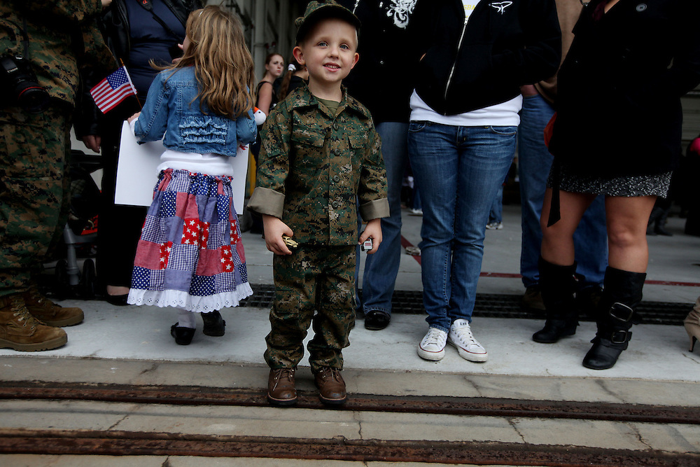 SAN DIEGO, CA-DEC. 17:   Braeden Brown smiles as he waits for his Dad to arrive home from a Seven Month deployment at Miramar Marine Corp Air Station in San Diego, California on Friday, December 17, 2010.  More than 200 Marines and Sailors assigned to the 15th Marine Expeditionary Unit aboard the U.S.S. Pelileu arrived home after supporting combat operations in Afghanistan.(Photo by Sandy Huffaker/Getty Images)