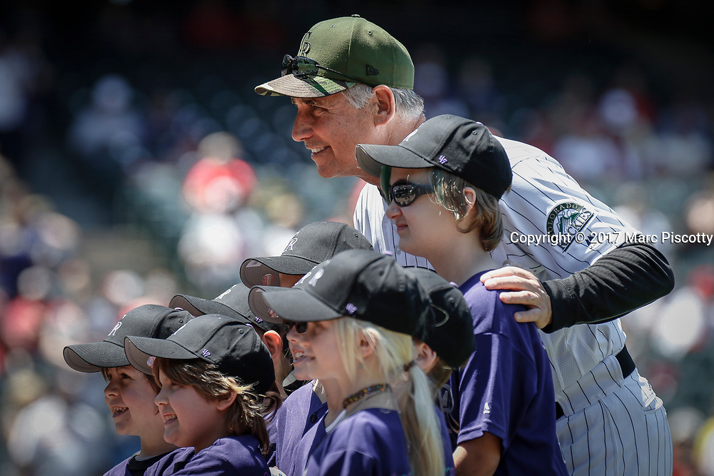 SHOT 5/28/17 11:49:54 AM - Colorado Rockies manager Bud Black poses for a picture with some young fans before his team faces the St. Louis Cardinals during a regular season MLB game at Coors Field in Denver, Co. The Rockies won the game 8-4. (Photo by Marc Piscotty / © 2017)
