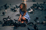 Girl in Christopher Columbus Park feeding pigeons, Barcelona, Spain...Media Usage:.Subject photograph(s) are copyrighted Edward McCain. All rights are reserved except those specifically granted by McCain Photography in writing...McCain Photography.211 S 4th Avenue.Tucson, AZ 85701-2103.(520) 623-1998.mobile: (520) 990-0999.fax: (520) 623-1190.http://www.mccainphoto.com.edward@mccainphoto.com
