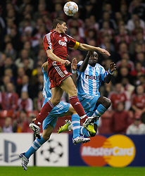 Liverpool, England - Wednesday, October 3, 2007: Liverpool's Steven Gerrard MBE and Olympique de Marseille's Mamadou Niang and Boudewijn Zenden during the UEFA Champions League Group A match at Anfield. (Photo by David Rawcliffe/Propaganda)