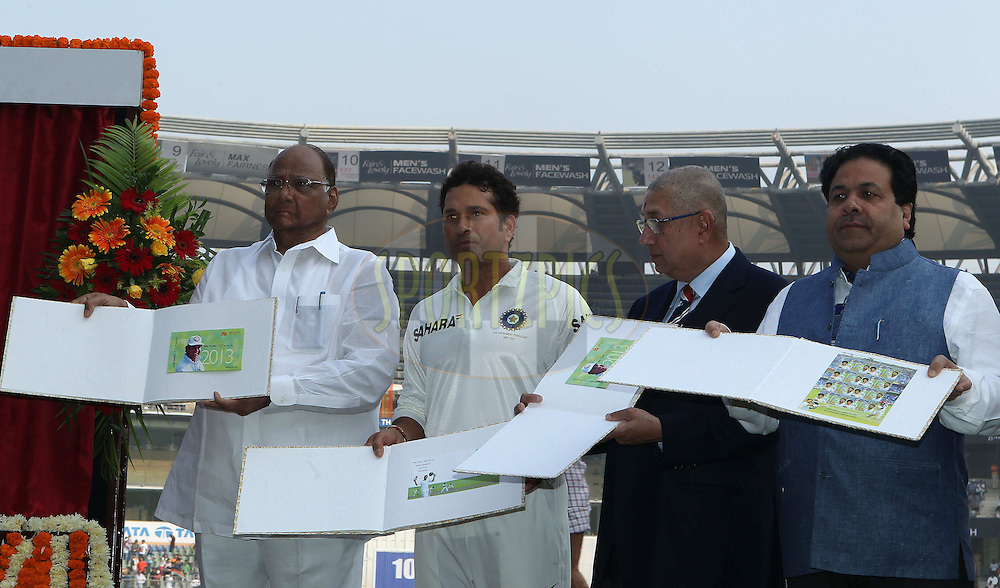Sachin Tendulkar , S Srinivasan and Rajeev Shukla pose with the stamp album produced to commemorate the launch of the stamp in honour of Sachin Tendulkar of India  during day one of the second Star Sports test match between India and The West Indies held at The Wankhede Stadium in Mumbai, India on the 14th November 2013<br /> <br /> This test match is the 200th test match for Sachin Tendulkar and his last for India.  After a career spanning more than 24yrs Sachin is retiring from cricket and this test match is his last appearance on the field of play.<br /> <br /> <br /> Photo by: Ron Gaunt - BCCI - SPORTZPICS<br /> <br /> Use of this image is subject to the terms and conditions as outlined by the BCCI. These terms can be found by following this link:<br /> <br /> http://sportzpics.photoshelter.com/gallery/BCCI-Image-Terms/G0000ahUVIIEBQ84/C0000whs75.ajndY