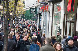 © Licensed to London News Pictures. 19/12/2011. London, UK. Shoppers on Oxford Street, London today. With only one week of shopping remaining before Christmas, stores have enjoyed their busiest weekend of the year with over £1Million GBP being spent on Saturday alone. Photo credit: Ben Cawthra/LNP