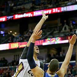 Jan 6, 2016; New Orleans, LA, USA; New Orleans Pelicans forward Anthony Davis (23) shoots over Dallas Mavericks forward Dwight Powell (7) during the second half of a game at the Smoothie King Center. The Mavericks defeated the Pelicans 100-91. Mandatory Credit: Derick E. Hingle-USA TODAY Sports