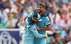 England's Eoin Morgan (left) and Liam Plunkett celebrate the run out of South Africa's Dwaine Pretorius during the ICC Cricket World Cup group stage match at The Oval, London.