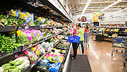 ROGERS, AR - OCTOBER 12:  Customers selecting vegetables at Walmart Store #4208 on October 12, 2015 in Rogers, Arkansas.  <br /> CREDIT Wesley Hitt for Wall Street Journal<br /> WALSQUEEZE