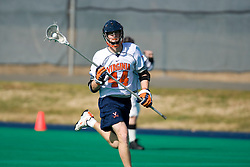 Virginia defenseman Mike Timms (44) in action against Navy.  The Virginia Cavaliers scrimmaged the Navy Midshipmen in lacrosse at the University Hall Turf Field  in Charlottesville, VA on February 2, 2008.
