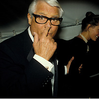 "Cary Grant points to his nose, remarking to the photographer, ""aim here,"" as he and his wife Barabara enter the 1984 gala for the Princess Grace Foundation Awards in Washington, DC."