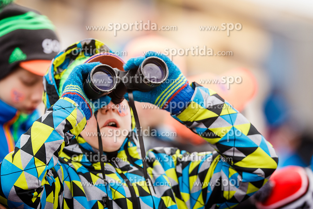 Kid with binocular during the Ski Flying Hill Individual Qualification at Day 1 of FIS Ski Jumping World Cup Final 2017, on March 22, 2017 in Planica, Slovenia. Photo by Grega Valancic / Sportida