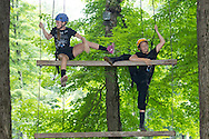 Town of Wallkill, New York - Shyla Macaluso, left, and Makayla Stoltz climb a ladder during a Ninja Warrior Day Camp trip to Ring Homestead Camp on July 8, 2014.