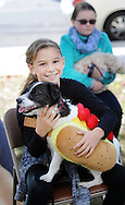 Brooke Alexander holds her dog Shadow in her lap as Rev. Jeffrey A. Wargo (not seen) conducted a blessing of pets Sunday, October 23, 2016 at St. Stephen's United Church of Christ in Perkasie, Pennsylvania. (Photo by William Thomas Cain)