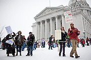 Protestors congregate outside the  Wisconsin State Capitol over a bill that threatens to strip collective bargaining rights in Madison, Wisconsin, February 26, 2011. Crowds swelled Saturday as protests enter their 12th day.