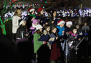 Hamptonburgh, New York  - Girls from the St. Stephen-St. Edward School chorus sing before the Tree lighting ceremony at Thomas Bull Memorial Park on Dec. 1, 2011.