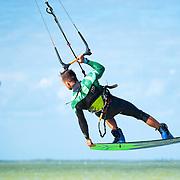 Man kiteboarding, mid-air at Isla Blanca. Cancun, Mexico.
