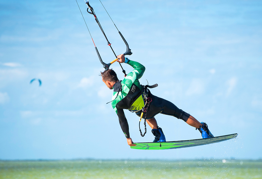 Man kiteboarding, mid-air at Isla Blanca. Cancun, Mexico.