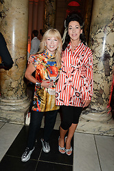 Left to right, TOYAH WILCOX and HELEN DAVID at the opening of Club To Catwalk: London Fashion In The 1980's an exhibition at The V&A Museum, London on 8th July 2013.