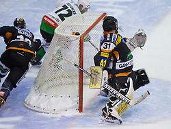 John Hughes (HDD Tilia Olimpija, #72) skates around the goal of Fabian Weinhandl (Moser Medical Graz 99ers, #31) and scores a goal during of ice-hockey match between Moser Medical Graz 99ers and HDD Tilia Olimpija in 11th Round of EBEL league, on October 14, 2011 at Eisstadion Graz-Liebenau, Graz, Austria. (Photo By Matic Klansek Velej / Sportida)